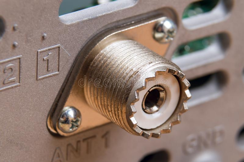 UHF connector on a block with flange stock photo