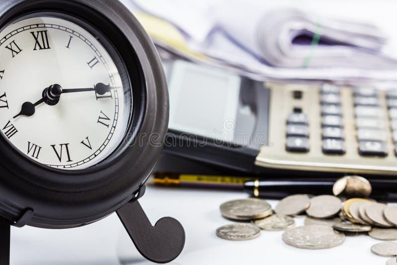 Uhr und Arbeit stockfoto