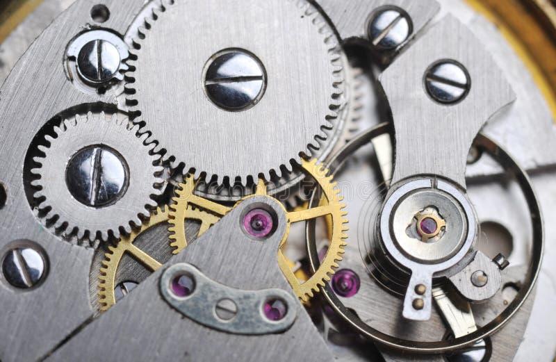 Uhrgänge schließen oben lizenzfreies stockfoto
