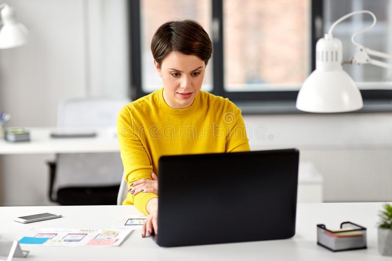 Ui designer with laptop working at office royalty free stock images