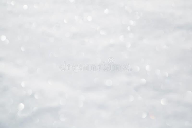 Uit achtergrond van de nadruk de samenvatting vage sneeuw bokeh stock foto's