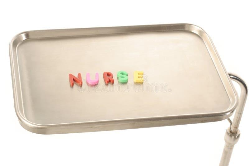 Uit gespelde verpleegster stock fotografie