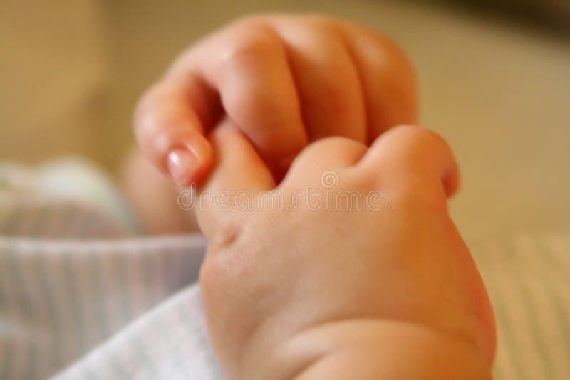 Uiterst kleine handen royalty-vrije stock afbeelding