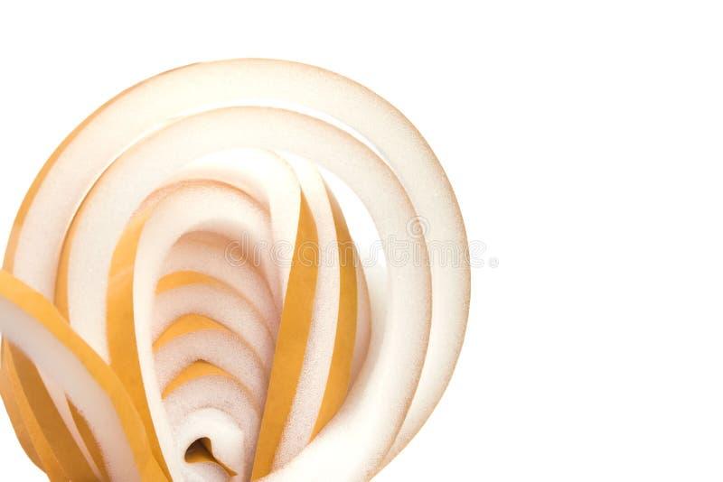 Uitgerold broodje van dikke gele rubberisolatievensters stock afbeelding
