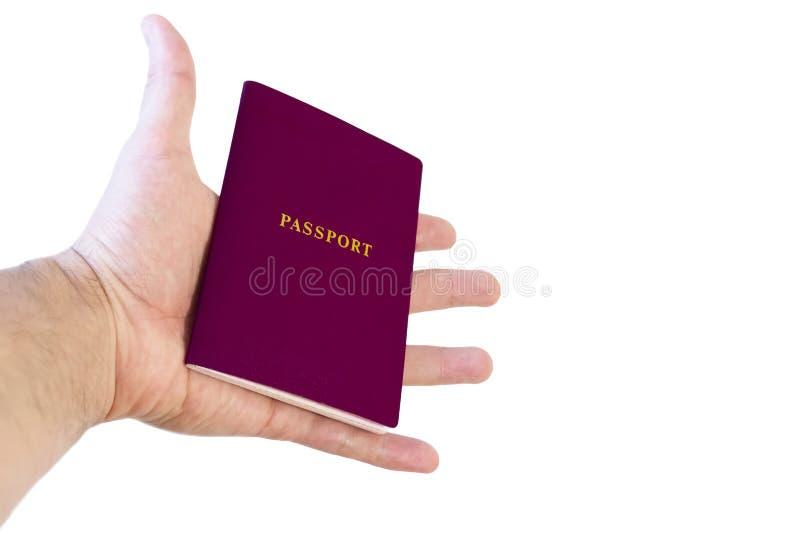 Uitgestrekte hand met een paspoort Concept - reizen, die documenten verkrijgen Geïsoleerdj op witte achtergrond royalty-vrije stock foto