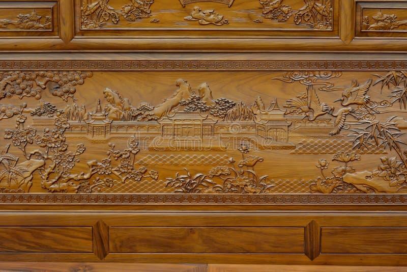 Uitstekend beeldhouwwerk op houten meubilair in Chinese in traditionele stijl royalty-vrije stock afbeelding