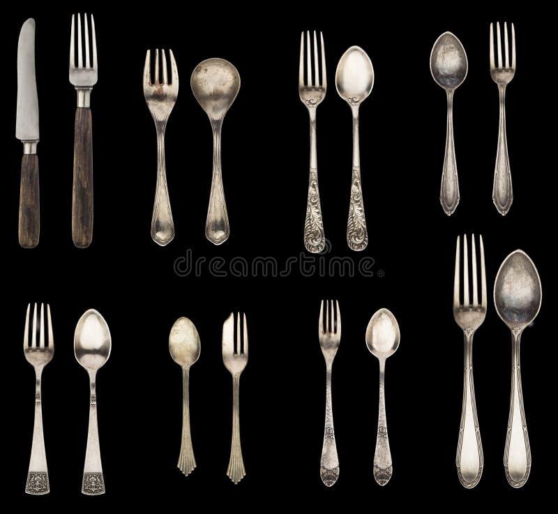 Uitstekend die lepel, vork en mes op een zwarte achtergrond wordt ge?soleerd Retro tafelzilver royalty-vrije stock foto's