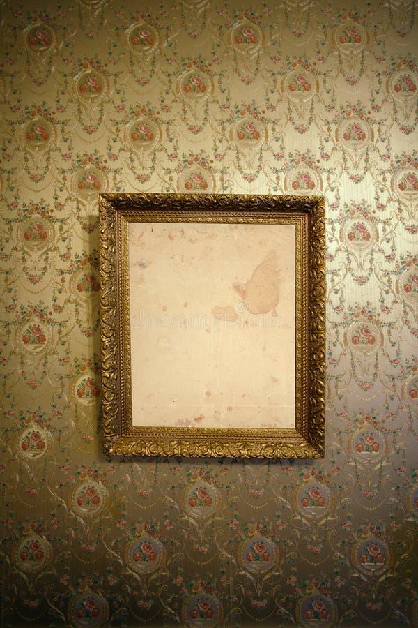Uitstekend gouden frame en behang stock fotografie