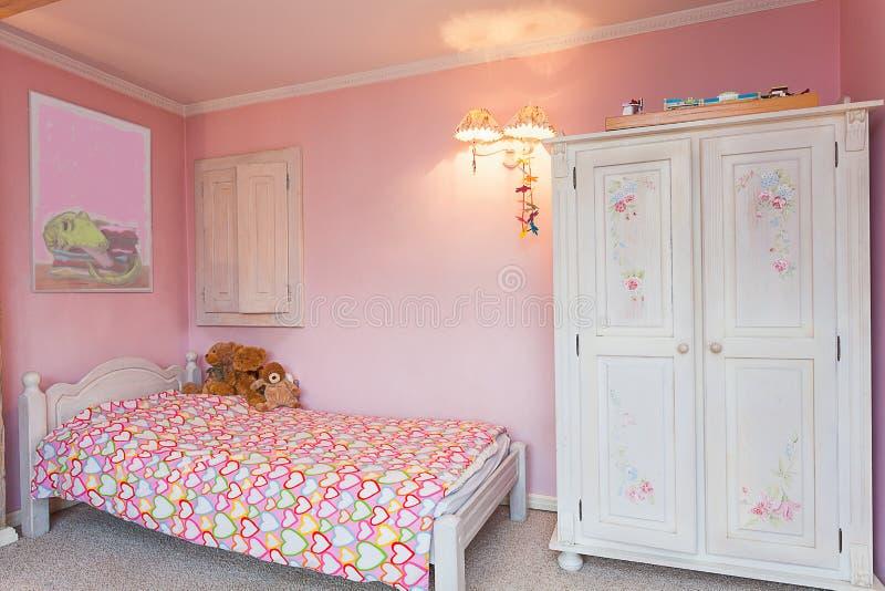 Uitstekend herenhuis - roze slaapkamer stock foto's