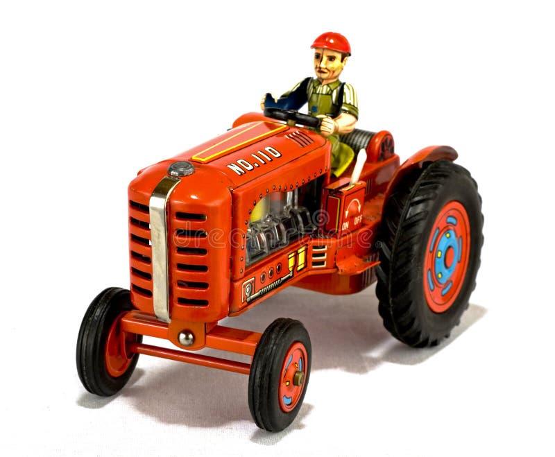 Uitstekend rood tractorstuk speelgoed stock afbeelding