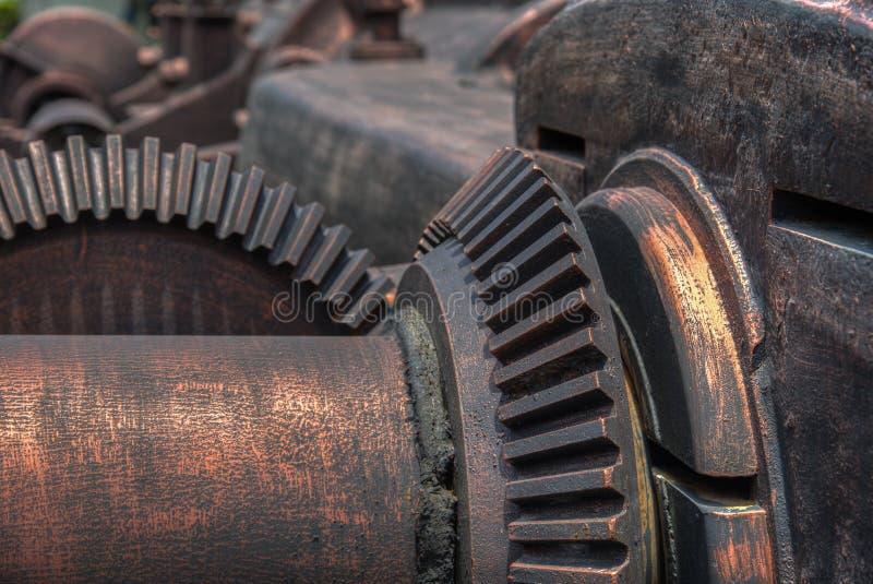 Uitstekend toestelwiel in koloniale fabriek royalty-vrije stock afbeeldingen