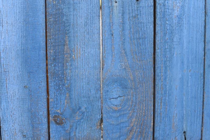 uitstekende blauwe geschilderde houten textuur als achtergrond met knopen De blauwe abstracte van het achtergrond of korrelruimte royalty-vrije stock foto