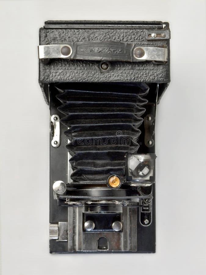 Uitstekende camera in zwarte op een witte achtergrond stock foto