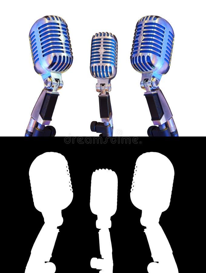 Uitstekende die microfoon drie op wit wordt geïsoleerd royalty-vrije stock fotografie