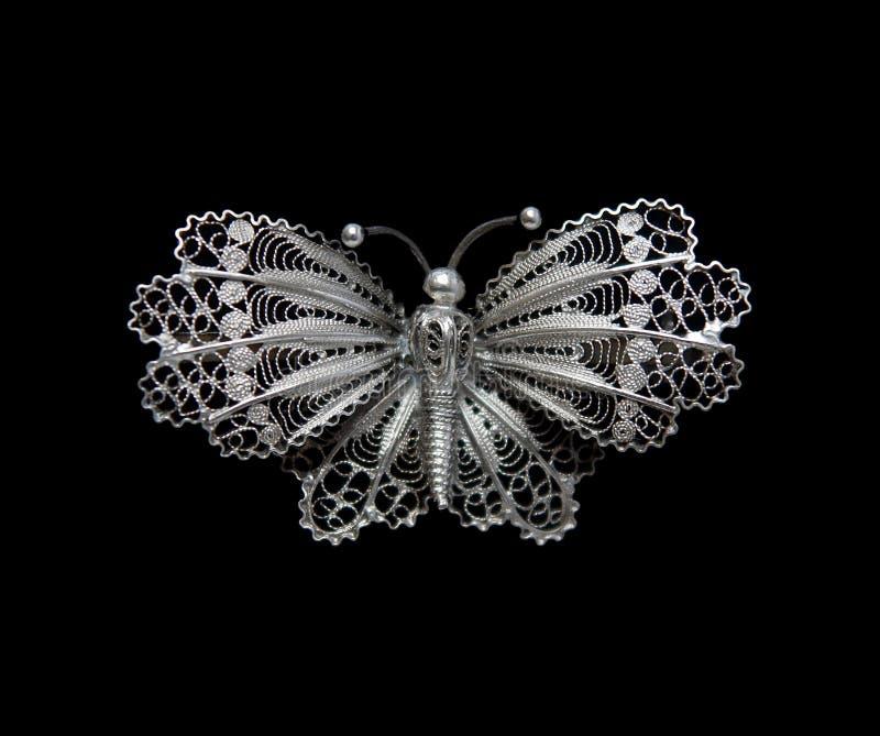 Uitstekende filigraan zilveren brochevlinder stock afbeelding