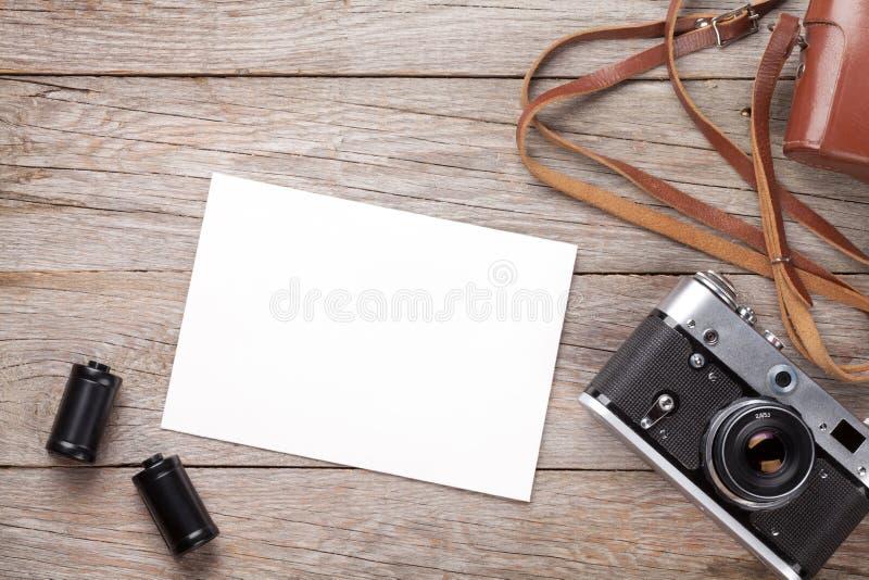 Uitstekende filmcamera en leeg fotokader royalty-vrije stock fotografie