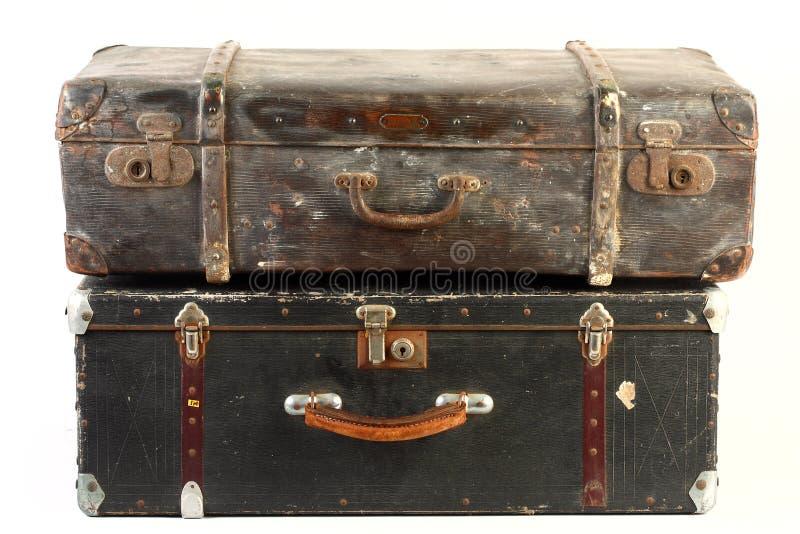 Uitstekende geïsoleerde koffers stock foto's