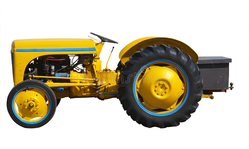 Uitstekende Gele Tractor royalty-vrije stock afbeelding