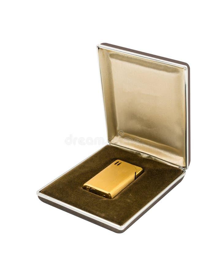 Uitstekende gouden aansteker in bruine luxe en goud packagin stock afbeeldingen