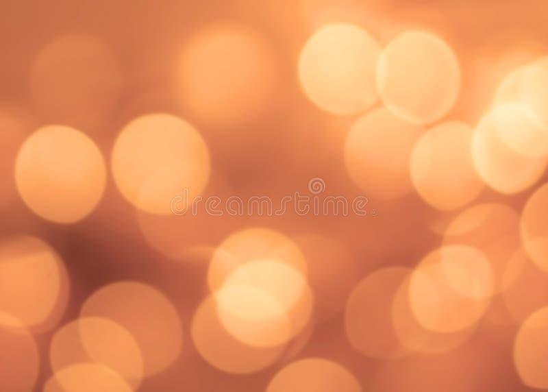 Uitstekende Kerstmisachtergrond met bokehlichten Gouden Defocused royalty-vrije stock foto's