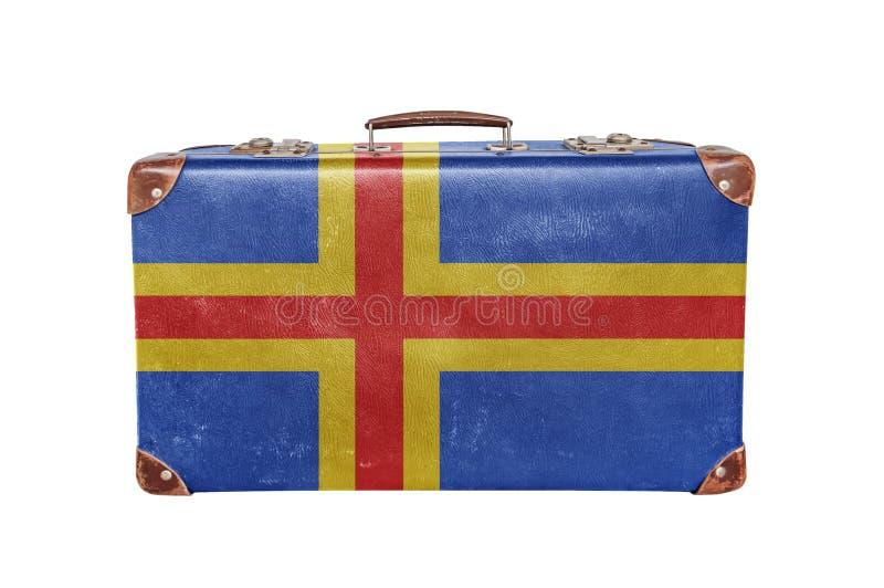Uitstekende koffer met Aland-Eilandvlag royalty-vrije stock fotografie