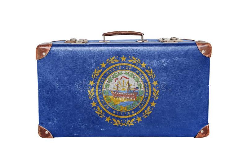 Uitstekende koffer met New Hampshire-vlag stock afbeelding
