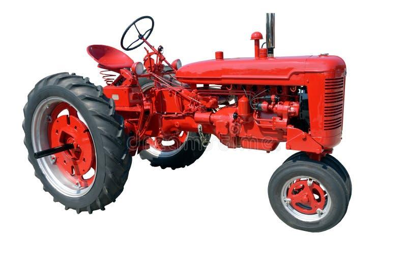 Uitstekende landbouwbedrijftractor stock afbeelding