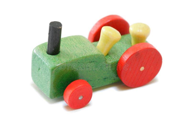Uitstekende miniatuur houten tractor royalty-vrije stock foto's