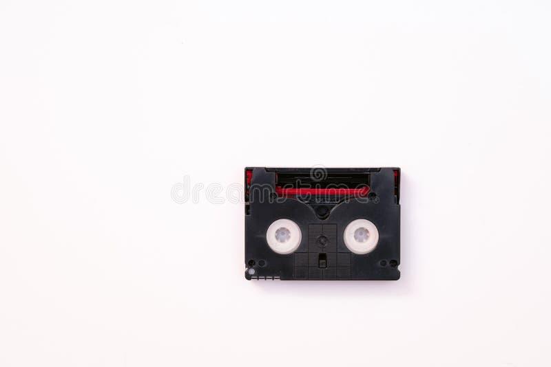 Uitstekende minidieDV-cassetteband voor opnamevideo terug wordt gebruikt in een dag Plastic, magnetische, analoge filmband op wit stock foto's