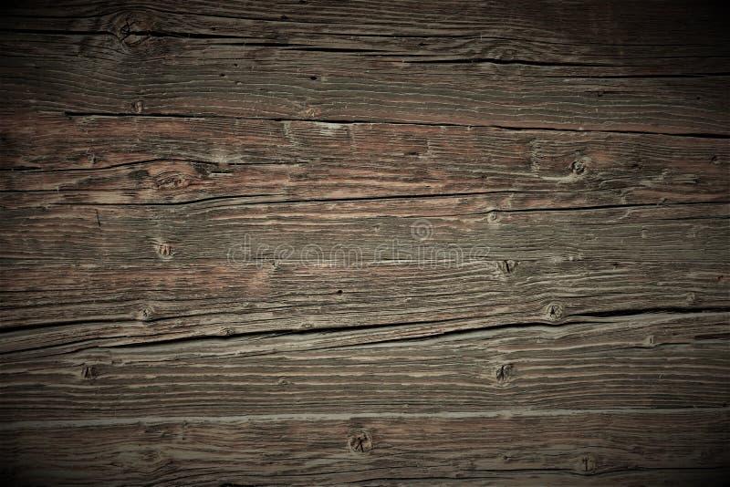 Uitstekende mooie bruine houten oppervlakte met het verdonkeren bij de randen stock afbeelding