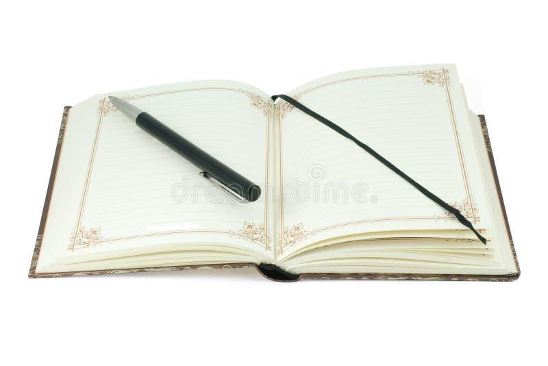 Uitstekende notitieboekje en penzwarte stock afbeeldingen
