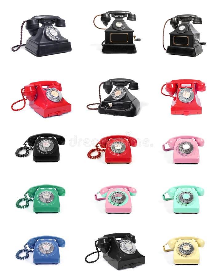 Uitstekende Oude Retro Roterende Wijzerplaattelefoons op Wit stock foto