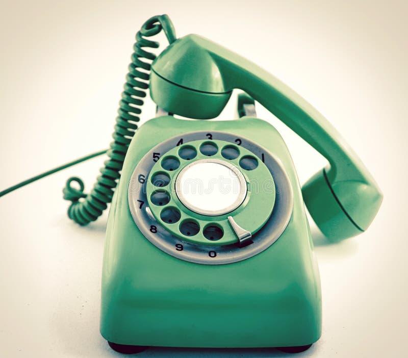 Uitstekende retro groene telefoon royalty-vrije stock afbeeldingen