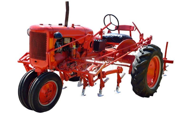 Uitstekende rode tractor stock fotografie