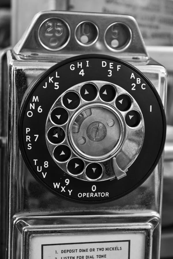 Uitstekende Roterende Publieke telefooncel - Oude Publieke telefooncel stock afbeelding