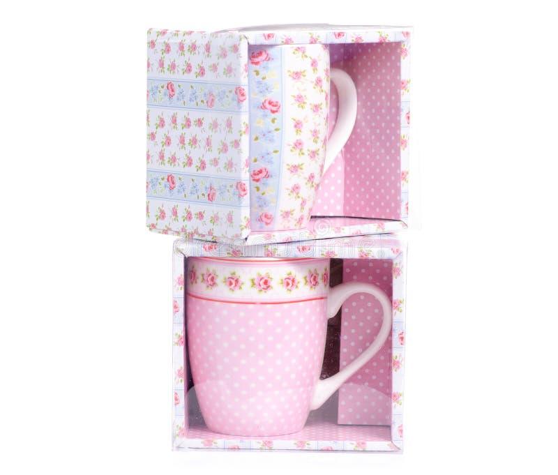 Uitstekende roze blauwe de bloemdozen van de koppenmok stock fotografie