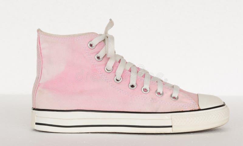 Uitstekende stijl van schoen van de sport de roze tennisschoen op witte achtergrond royalty-vrije stock fotografie