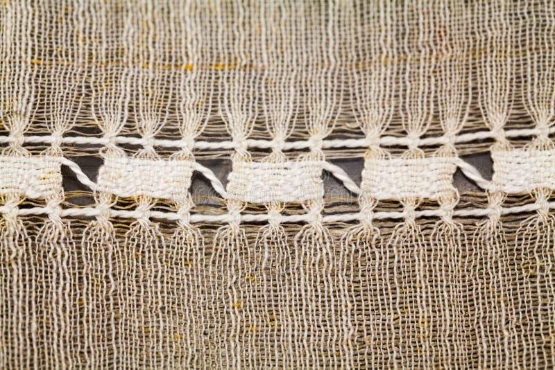 Uitstekende textieltextuur met fijn borduurwerk stock afbeeldingen