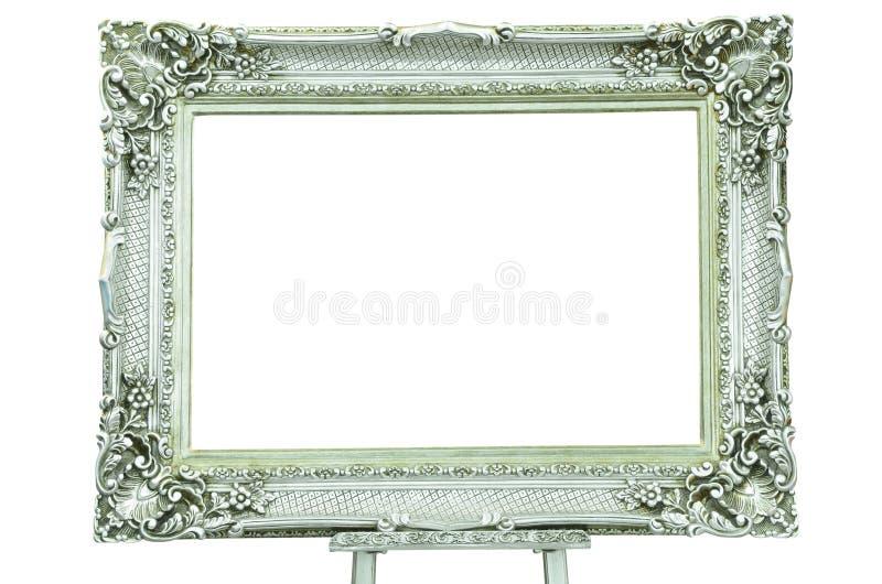 Uitstekende zilveren omlijsting met metaalschildersezel royalty-vrije stock afbeelding