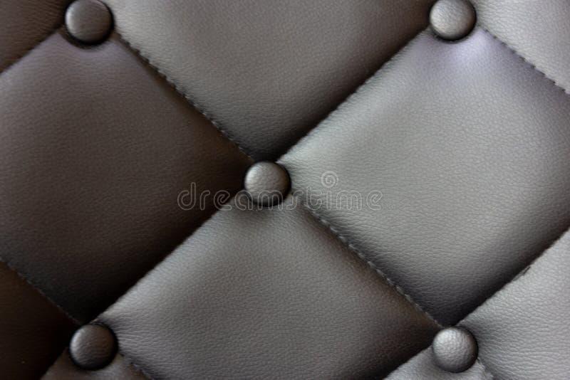 Uitstekende zwarte meubilairtextuur, de bankachtergrond van het Patroon zwarte leer stock fotografie
