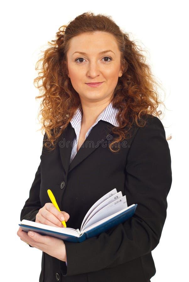 Uitvoerende vrouwen met persoonlijke agenda royalty-vrije stock foto