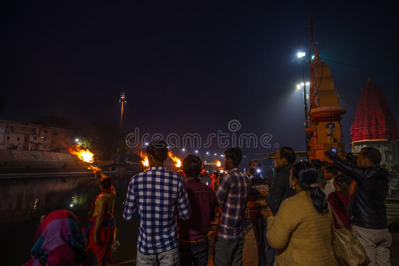 Ujjain, India - December 7, 2017: People attending religious ceremony on holy river at Ujjain, India, sacred town for Hindu relig. Ion royalty free stock photography