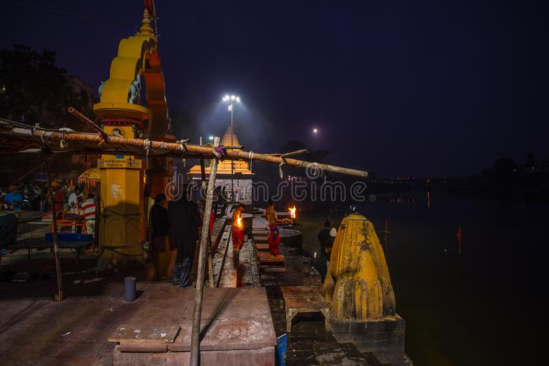 Ujjain, India - December 7, 2017: People attending religious ceremony on holy river at Ujjain, India, sacred town for Hindu relig. Ion royalty free stock images