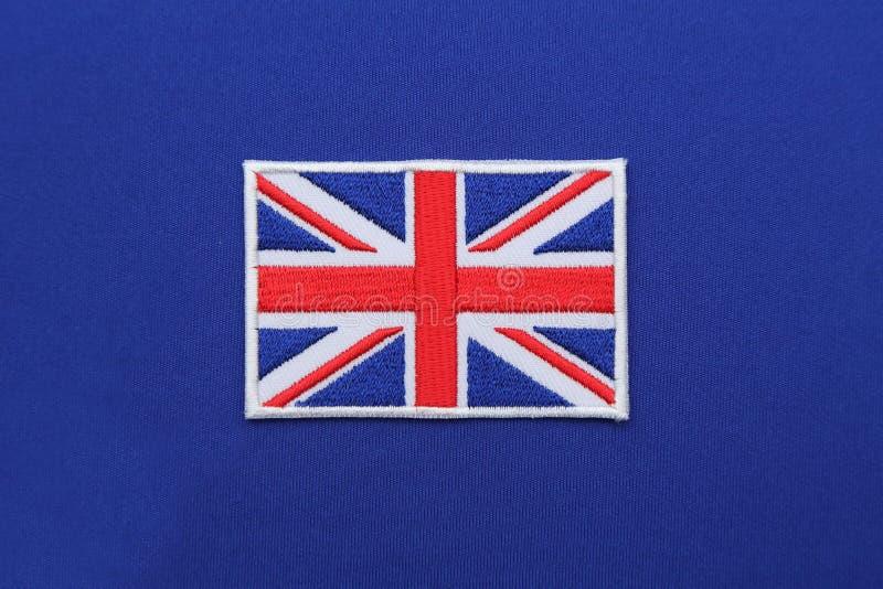 UK chorągwiana łata na tkaninie obraz royalty free