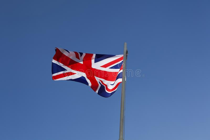 UK flag on a flagpole stock photography