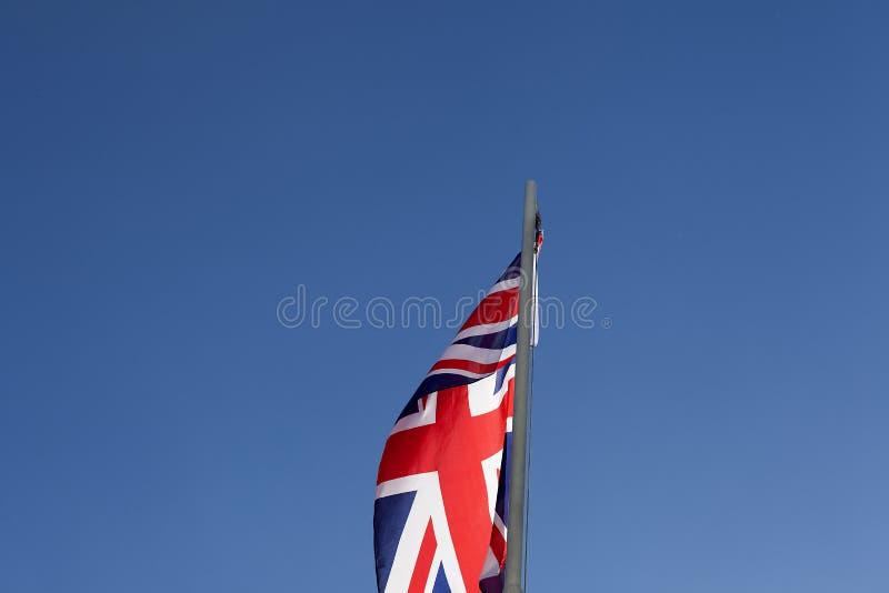 UK flag on a flagpole royalty free stock photo