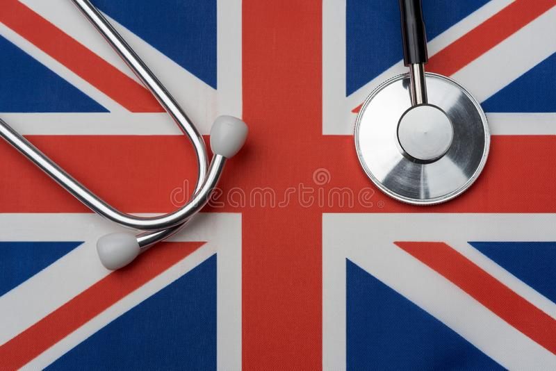 UK flag and stethoscope. The concept of medicine royalty free stock photos