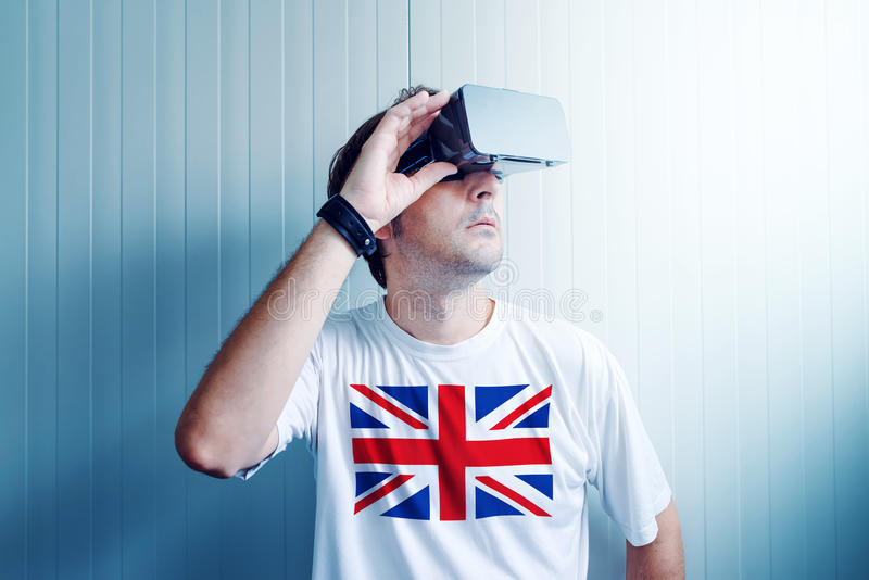 UK guy exploring virtual reality environment. And enjoying multimedia content in 3d stock image