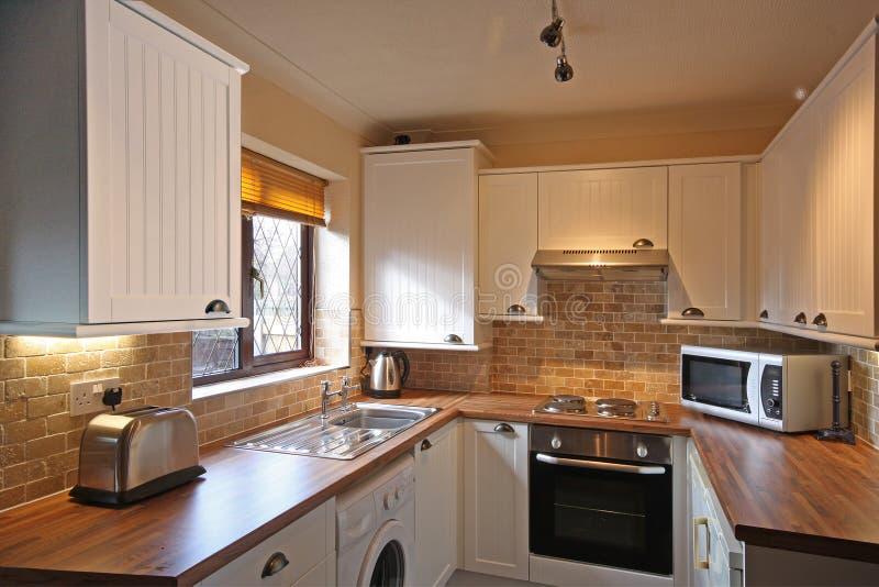 UK Kitchen. White kitchen in small UK Home royalty free stock photo