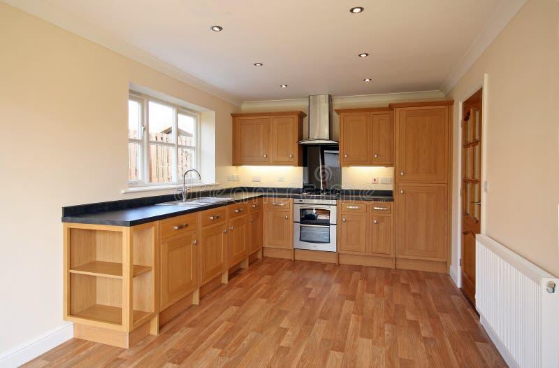 UK Luxury Beech Style Kitchen. Beech style luxury kitchen in UK home stock photography